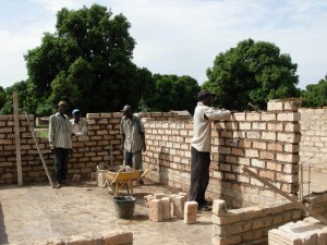Bricks are laid and then covered with mud and stucco