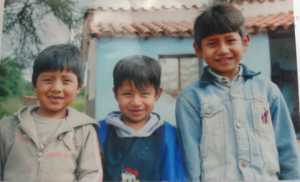3 of Benita's sons in front of their house